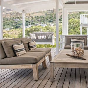 covered wooden deck outdoor furniture (Photo by Eric Audras / ONOKY via Getty Images )