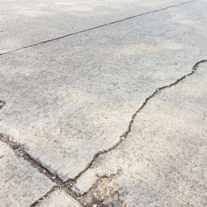 Cracked driveway (Photo by Nattawat-Nat / iStock / Getty Images Plus via Getty Images)
