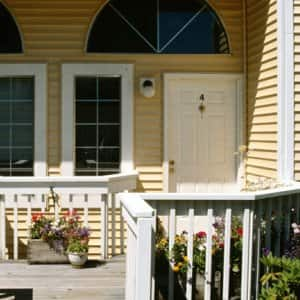 exterior front porch of duplex home, two doors (Photo by © Ablestock.com/Getty Images)