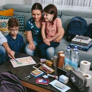 Family discussing emergency plan (Photo by David Pereiras - stock.adobe.com)