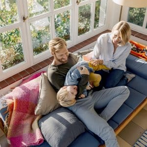 family playing on couch in sunroom (Photo by © Westend61/Alamy Stock Photo)