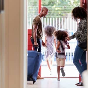 Family leaves for vacation (Photo by monkeybusinessimages / iStock / Getty Images Plus via Getty )
