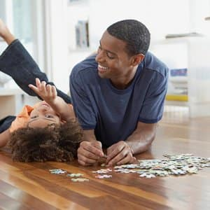A father and daughter put together a puzzle (Photo by Fancy/Veer/Corbis / Getty Images Plus via Getty Images)