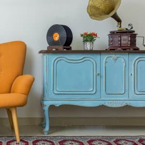 Retro armchair with antique sideboard (Photo by Khaled El-Adawi - stock.adobe.com)