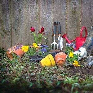 flower pots, pansies, garden tools
