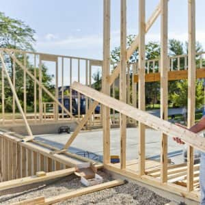 homebuilder carries lumber at new home construction site (Photo by Brandon Smith)