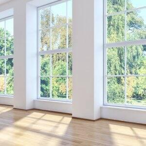 three sunny windows of an empty room overlooking trees (Photo by © 3DarcaStudio - stock.adobe.com)