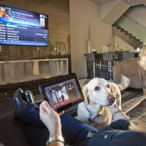 tablet controlling TV and thermostat (Photo by Photo by Eric Priddy  )
