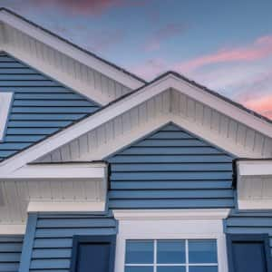 house with blue siding with sunset in background (Photo by © tamas - stock.adobe.com)