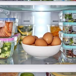 inside of fridge with food  (Photo by SKC/Stocksy - stock.adobe.com.)