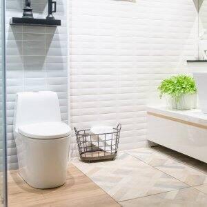 The interior of a modern bathroom with a white toilet (Photo by navintar - stock.adobe.com)