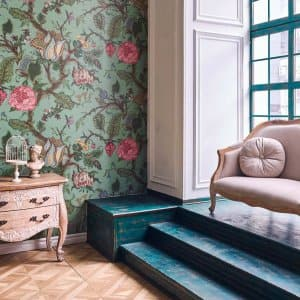 The interior of a loft with a floral wallpaper (Photo by Vostok/Moment via Getty Images)