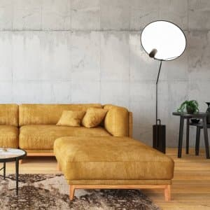 A living room with a yellow sofa (Photo by asbe/E+ via Getty Images)