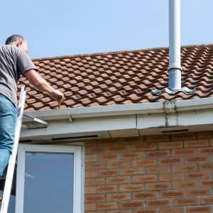 man cleaning roof (Photo by Alphotographic via Getty Images)