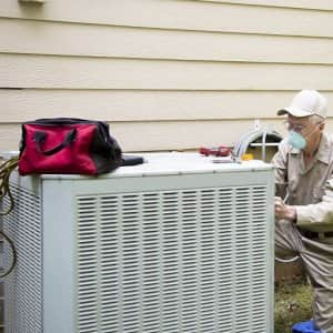 Man fixing air conditioner unite (Photo by LifestyleVisuals / E+ via Getty Images)