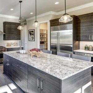 Modern gray kitchen with different countertops (Photo by Iriana Shiyan - stock.adobe.com)