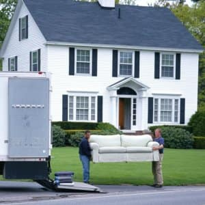 Movers loading furniture in truck (Photo by © Yellow Dog Productions / The Image Bank / Getty Images)