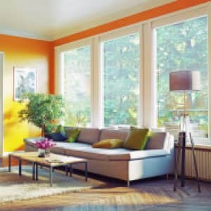 Brightly orange painted livingroom with white trim (Photo by vicnt/iStock/Getty Images Plus/Getty Images)