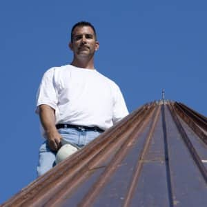 roofer on a copper roof