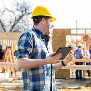 Construction manager and foreman discuss project (Photo by SDI Productions / E+ via Getty Images)