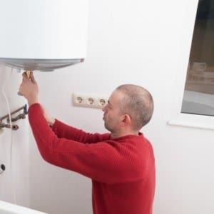 Man Repairing Water Heater (Photo by Photo by Ramon Espelt / EyeEm / Getty Images)