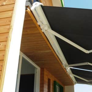 retractable patio awning in backyard (Photo by  Lex20 / iStock / Getty Images Plus via Getty Images)