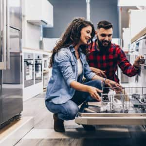 Couple shopping for kitchen appliances (Photo by hedgehog94 / Shutterstock.com)