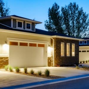 A suburban house with a garage in a neighborhood (Photo by RichLegg/E+ via Getty Images)