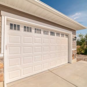 a tan garage door of a home garage (Photo by Jason Finn/iStock / Getty Images Plus/Getty Images.)