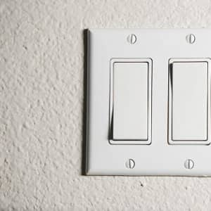 Three way wall switch (Photo by Image Source / Image Source via Getty Images)