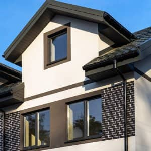 townhouse with black roof and black gutters (Photo by cherokee4 - stock.adobe.com)