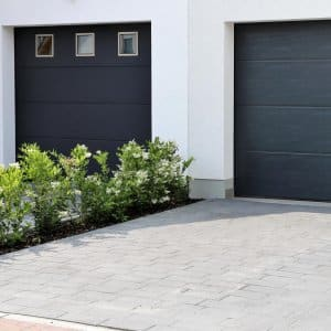 Two modern garage doors in a residential district (Photo by U. J. Alexander/iStock/Getty Images Plus via Getty Images)