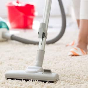 Suction grey carpet cleaning with vacuum cleaner (Photo by didesign021/ iStock / Getty Images Plus via Getty Images)