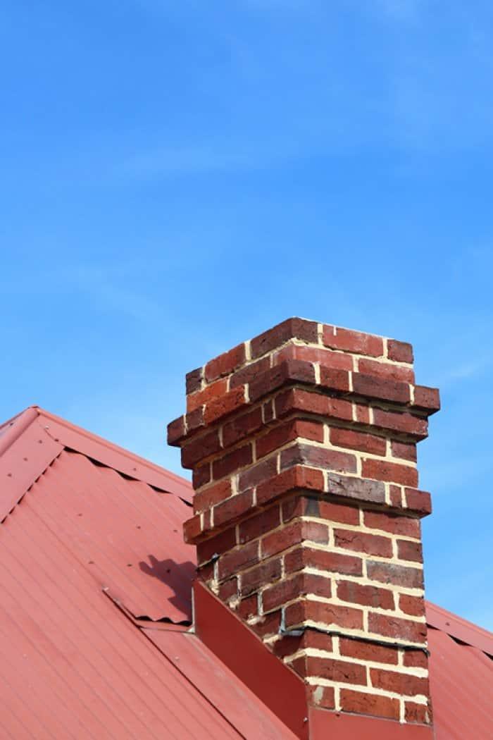 chimney on roof under blue sky