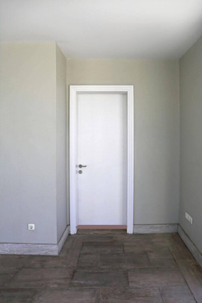 white door with draft stopper along bottom