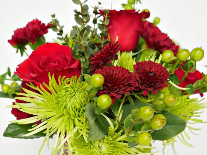 A full bouquet comprised of your favorite red and green flowers makes a beautiful holiday centerpiece. (Photo by Taryn Whiteaker/Design, Dining and Diapers)