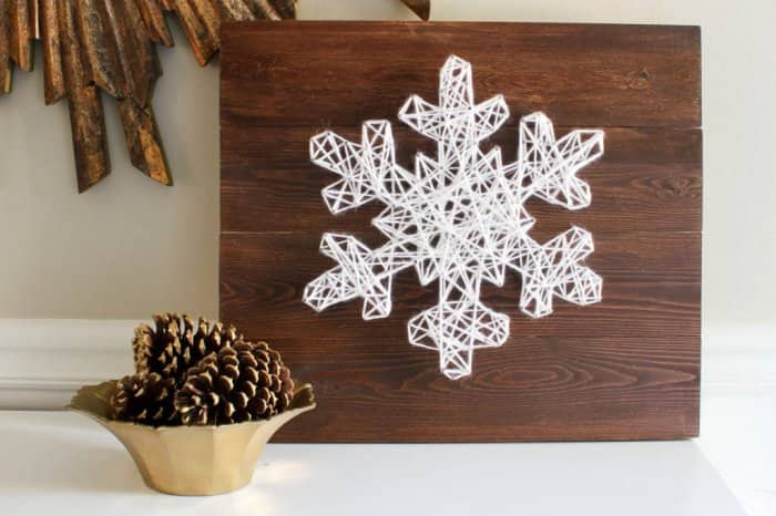 This DIY snowflake string art will look good throughout the winter. (Image courtesy of Erin Spain Blog)