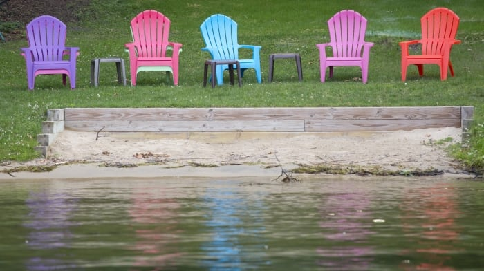 deck chairs by a lake
