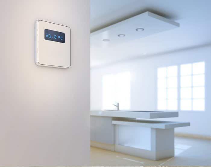 programmable thermostat on white wall