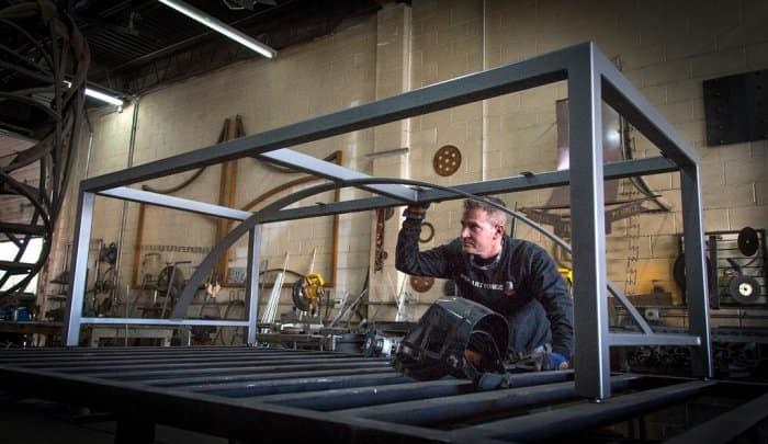 Ryan Feeney of Indy Art Forge checks out a metal table in progress