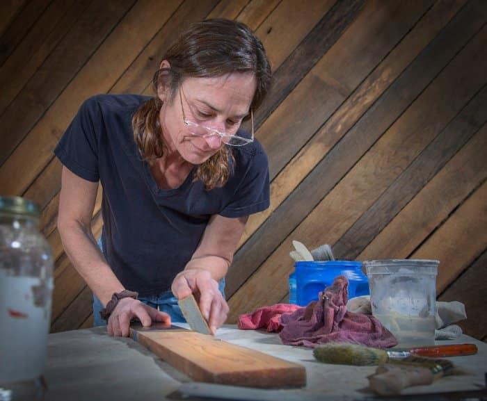 Wild Zen, Inc. owner Liza Oates creating faux finish on wood