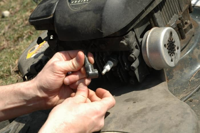 Changing a lawn mower spark plug