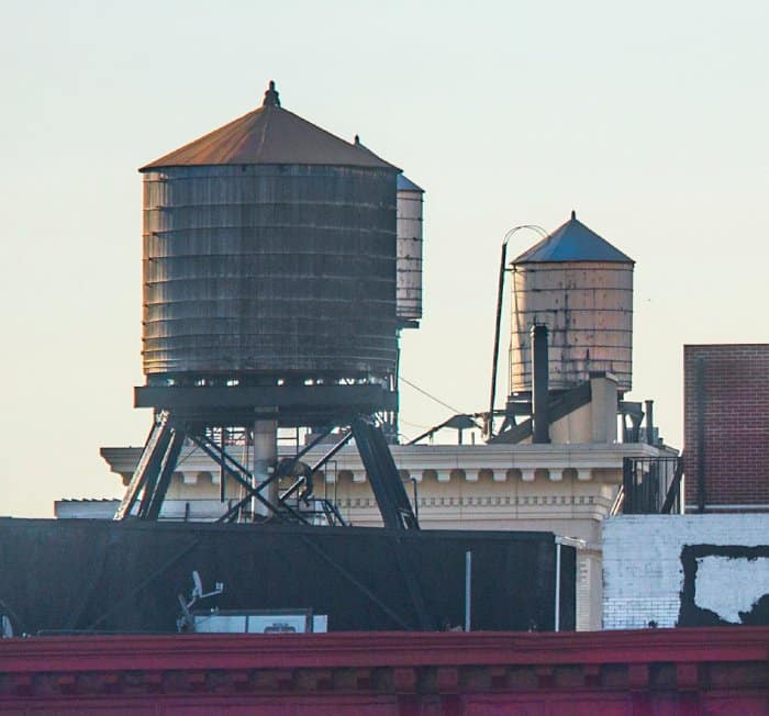 Wooden water towers atop buildings in New York City