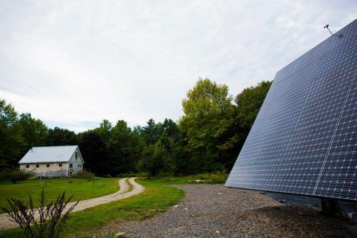 A Maine barn home with a yard solar array