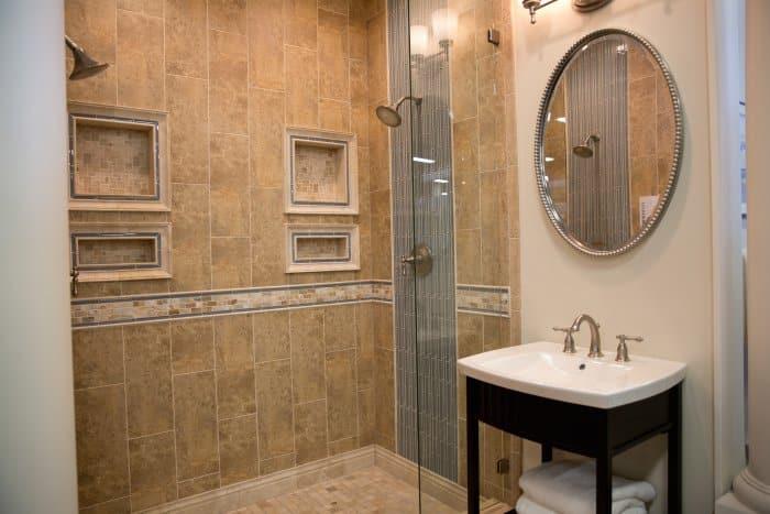 tiled bathroom with oval mirror
