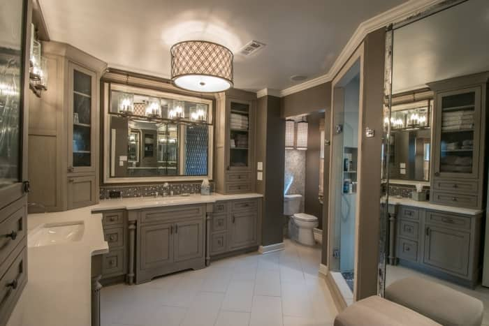 high-end master bathroom with custom cabinets, tile, lighting and mirrors