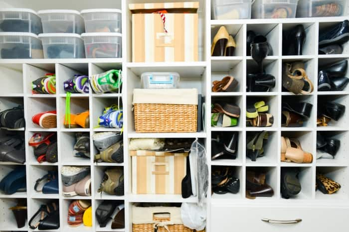 cubbies in closet full of shoes