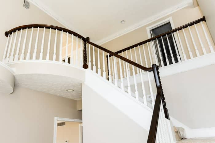 balcony black rail white stairs entry in foyer (Photo by Summer Galyan)