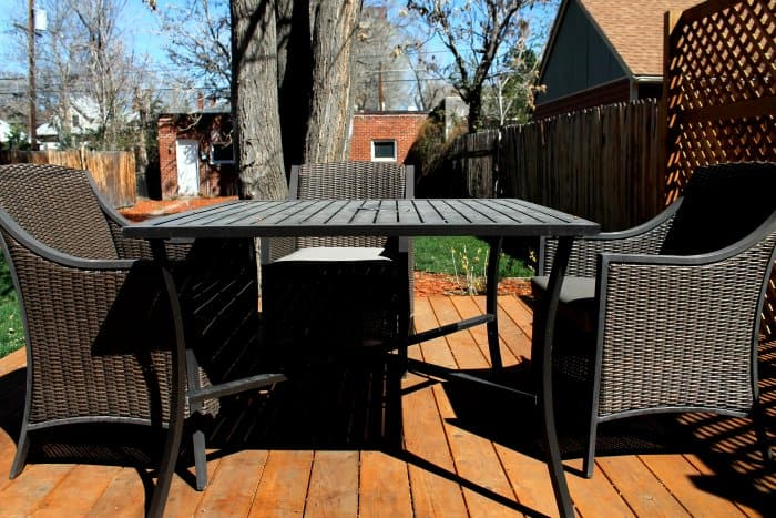 three chairs and table on deck