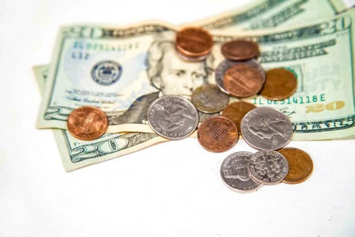 A stack of bills and coins